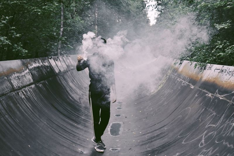 One Person Real People Water Full Length Lifestyles Men Day Leisure Activity Motion Nature Outdoors Smoke - Physical Structure