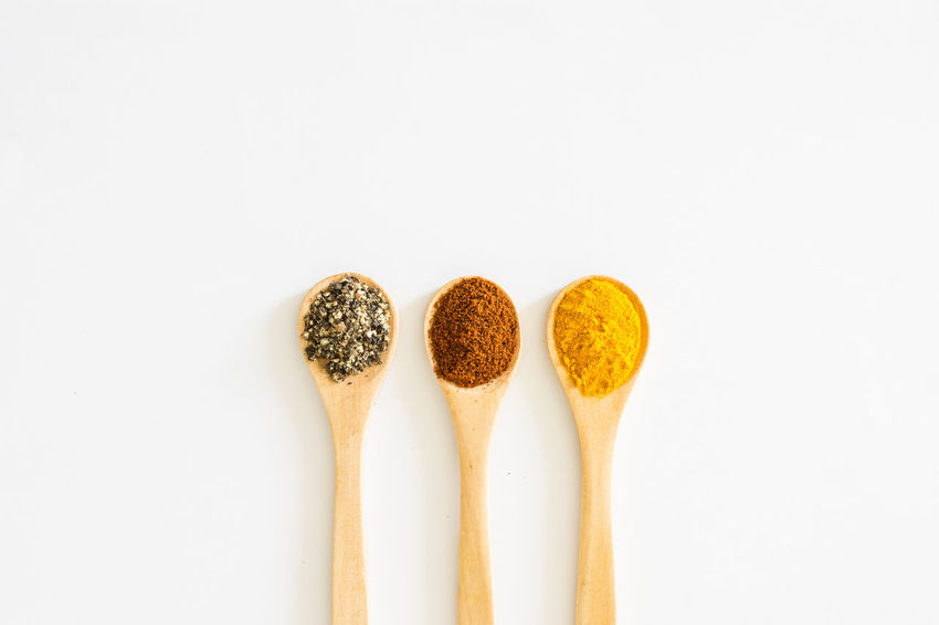 Turmeric, Paprika and Black Pepper in wooden spoon over white background. Aroma Aromatic Black Pepper Close-up Condiments  Curry Food Food And Drink Ingredient Isolated Paprika Powder Spices Studio Shot Turmeric  White Background Wooden Spoon