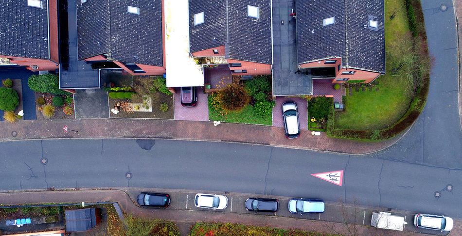 Single-family houses with parking cars in a suburb, aerial view with drone Aerial Shot Asphalt Cars Drone  Drone Dji Drone Shot Road Roof Rooftop Traffic Aerial Aerial Photography Aerial View Architecture Building Exterior Built Structure Car Day No People Outdoors Parking Scenics Street Traffic Sign Window