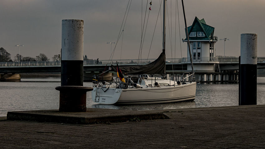sailing boat Man Sailing Ship Schlei Architecture Boat Bridge Building Exterior Built Structure Day Harbor Mast And Rope Mode Of Transport Moored Nature Nautical Vessel No People One Person Outdoors River Sailing Boat Sky Street Transportation Water Waterfront