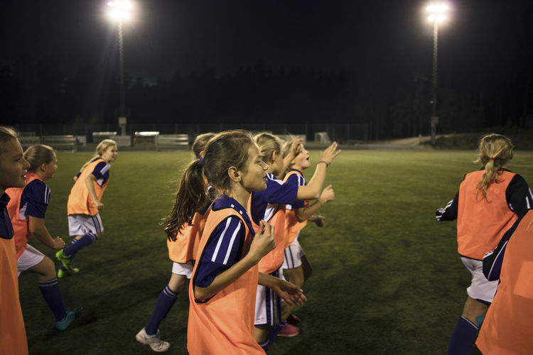 Group of people on soccer field at night