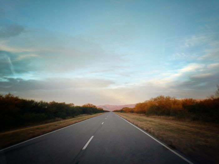Road against sky during sunset