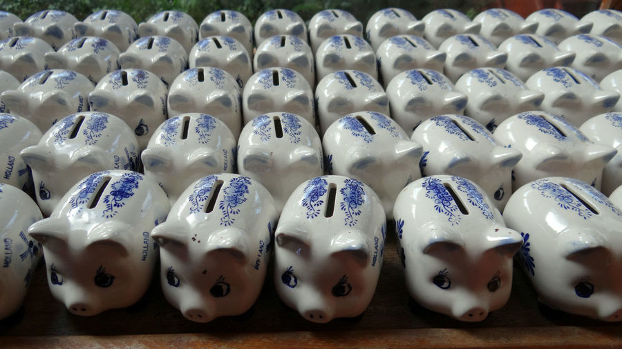 Piggy Banks Arranged On Table For Sale