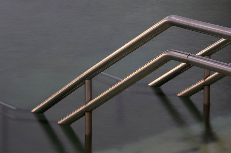 Architecture Day Focus On Foreground High Angle View Ladder Lake Metal Nature No People Outdoors Protection Railing Rain Safety Security Silver Colored Steel Water Wet