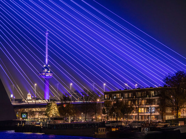 Illuminated Night Architecture Built Structure City Building Exterior Blue No People Bridge Sky Connection River Bridge - Man Made Structure Nature Water Transportation Motion Long Exposure Purple Light Nightlife