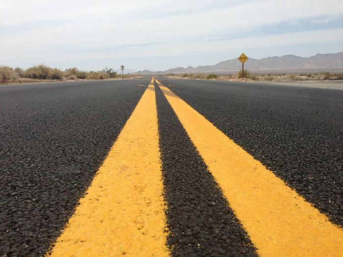 Empty road along empty road