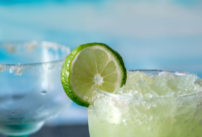 cold and icy frozen margarita drinks with slices of lime Frozen Margarita Margarita Summertime Alcohol Alcoholic Drinks Beach Drinks Citrus Fruit Close-up Cocktail Cold Drink Drink Umbrella Drinking Glass Empty Glass Food And Drink Freshness Frozen Beverage Fruit Garnish Glass Healthy Eating Icy Lime Refreshment SLICE