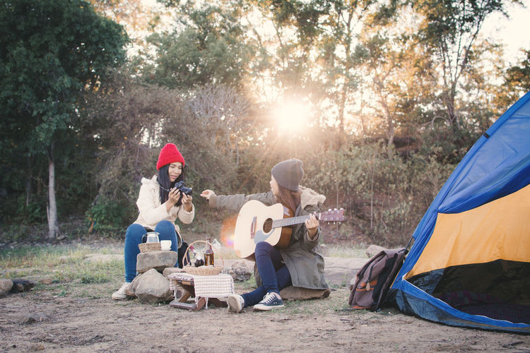 Adult Adventure Camping Day Friendship Guitar Leisure Activity Music Nature Outdoors People Playing Sitting Tent Togetherness Tree Vacations Young Women