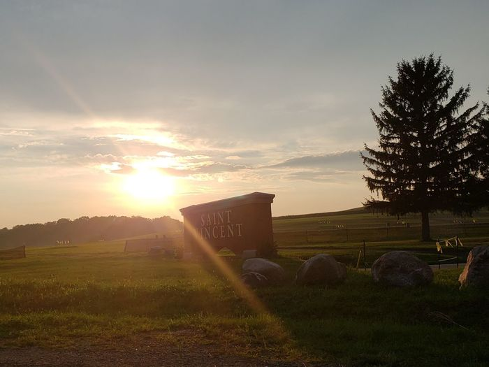 Entrance Pennsylvania Tranquil Scene Pennsylvania Beauty Beauty In Nature Tranquility Beautiful Sign College Saint Vincent College Tree Sunset Sunlight Sky Shining Sun Agricultural Field Farmland Sunbeam