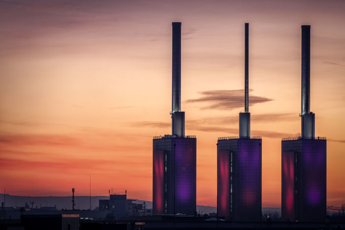 Die drei warmen Brüder EyeEmNewHere Hannover Heizkraftwerk  Power Plant Abendrot Architecture Building Exterior Built Structure City Cloud - Sky Environmental Issues Evening Evening Sky Illuminated Industrial Building  Industry Linden No People Orange Color Outdoors Pollution Sky Sunset Tall - High