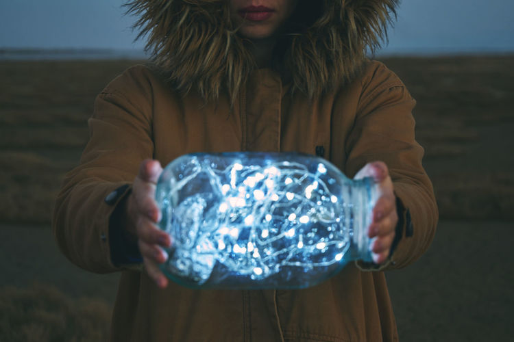 Close-Up Of A Woman Holding Jar Of Lights