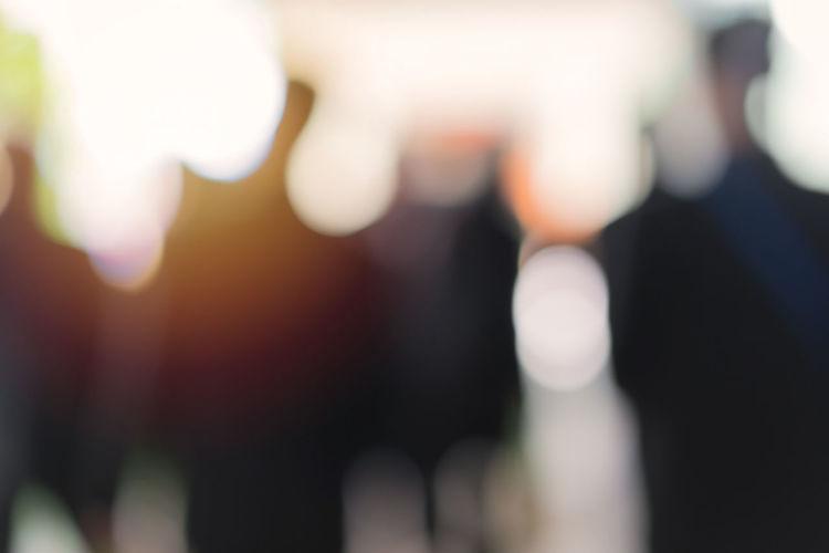 Defocused image of people against blurred background