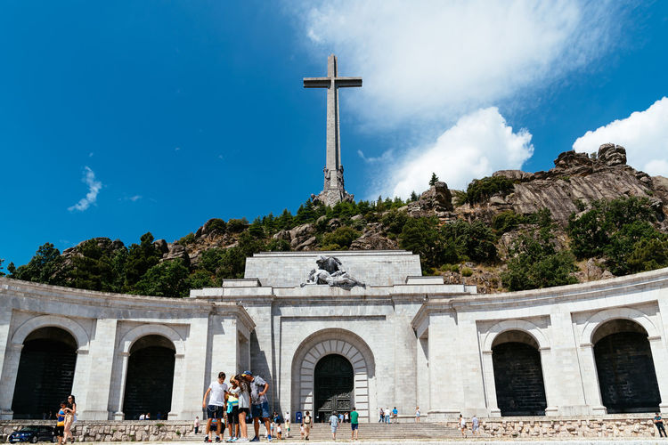 Basilica and big cross in the Valley of The Fallen in Madrid Basilica Cross El Escorial Madrid SPAIN Spanish Civil War Tomb Architecture Belief Built Structure Cross Europe Exhumation Franco History Nature Outdoors People Place Of Worship Politics And Government Real People Religion Sky Spirituality Valley Of The Fallen