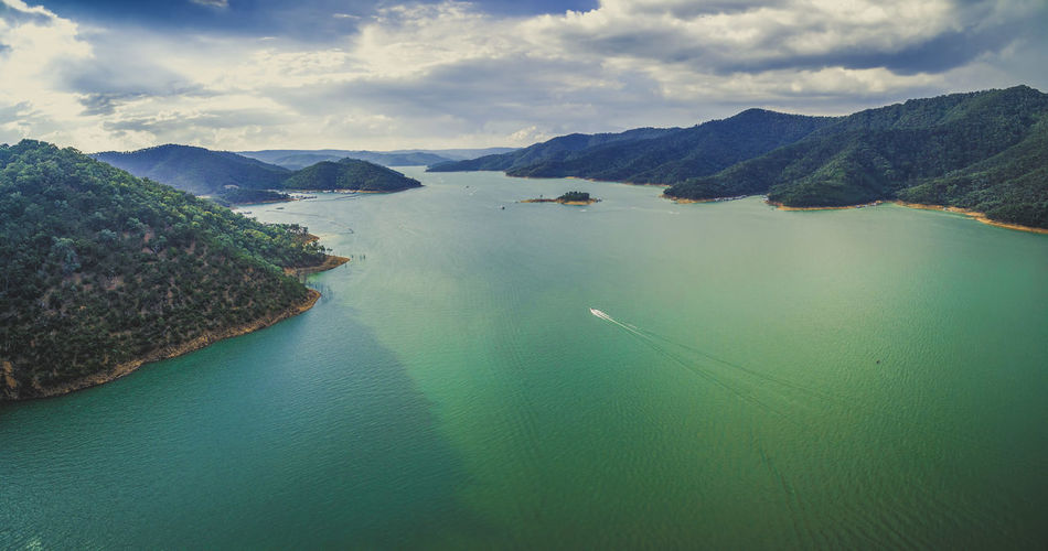 Aerial panorama of beautiful lake in the mountains Australia Australian Australian Landscape Drone  Nature Scenic View Aerial Aerial View Beauty In Nature Cloud - Sky Dam Day Drone Photography Eildon High Angle View Lake Lake Eildon Landscape Mountain Mountain Range Nature Nautical Vessel No People Outdoors Park Scenics Sea Sky Tranquil Scene Tranquility Water Waterfront
