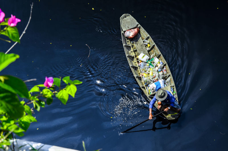 High angle view of man in floating boat