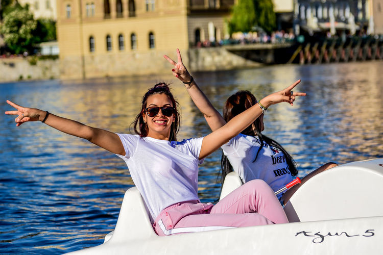 Adult Arms Raised Day Emotion Fashion Focus On Foreground Human Arm Leisure Activity Lifestyles Mode Of Transportation Nature Nautical Vessel Outdoors People Positive Emotion Real People Sea Sunglasses Togetherness Transportation Two People Water Women