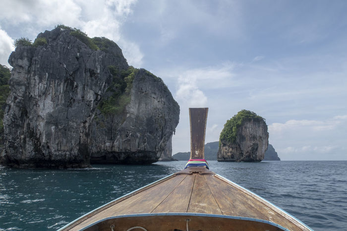 Water Sea Sky Nautical Vessel Mode Of Transportation Transportation Cloud - Sky Nature Beauty In Nature Day Scenics - Nature Rock No People Longtail Boat Rock Formation Rock - Object Solid Tranquil Scene Tranquility Outdoors Horizon Over Water Turquoise Colored Formation Thailand