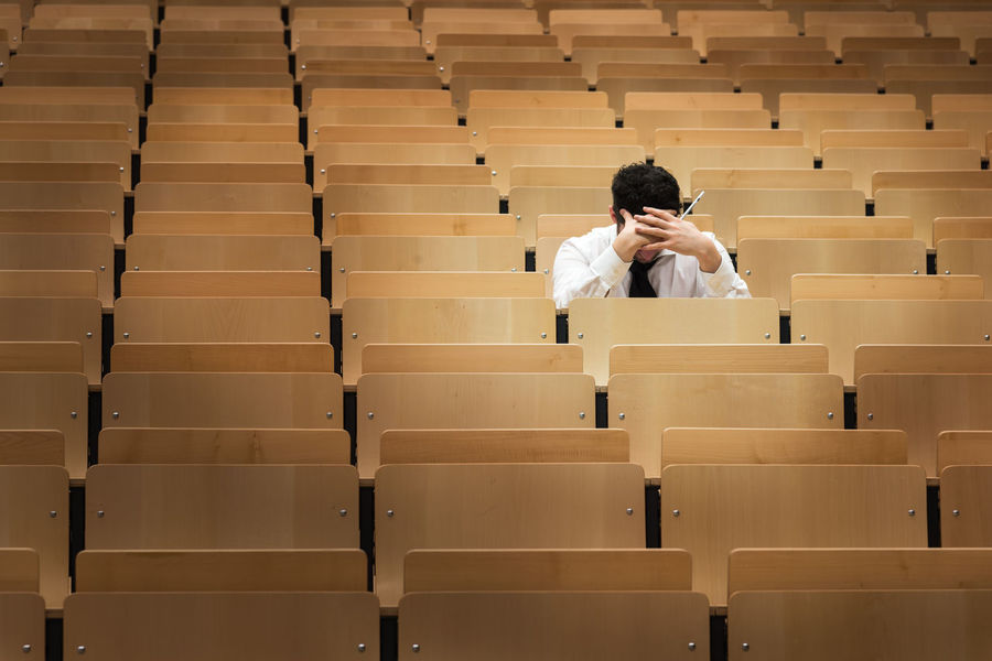 Campus Learning Library Auditorium Chair Classroom Day Education In A Row Indoors  Learning Lecture Hall Lifestyles Men One Person People Real People Seat Sitting Student University University Student Young Adult