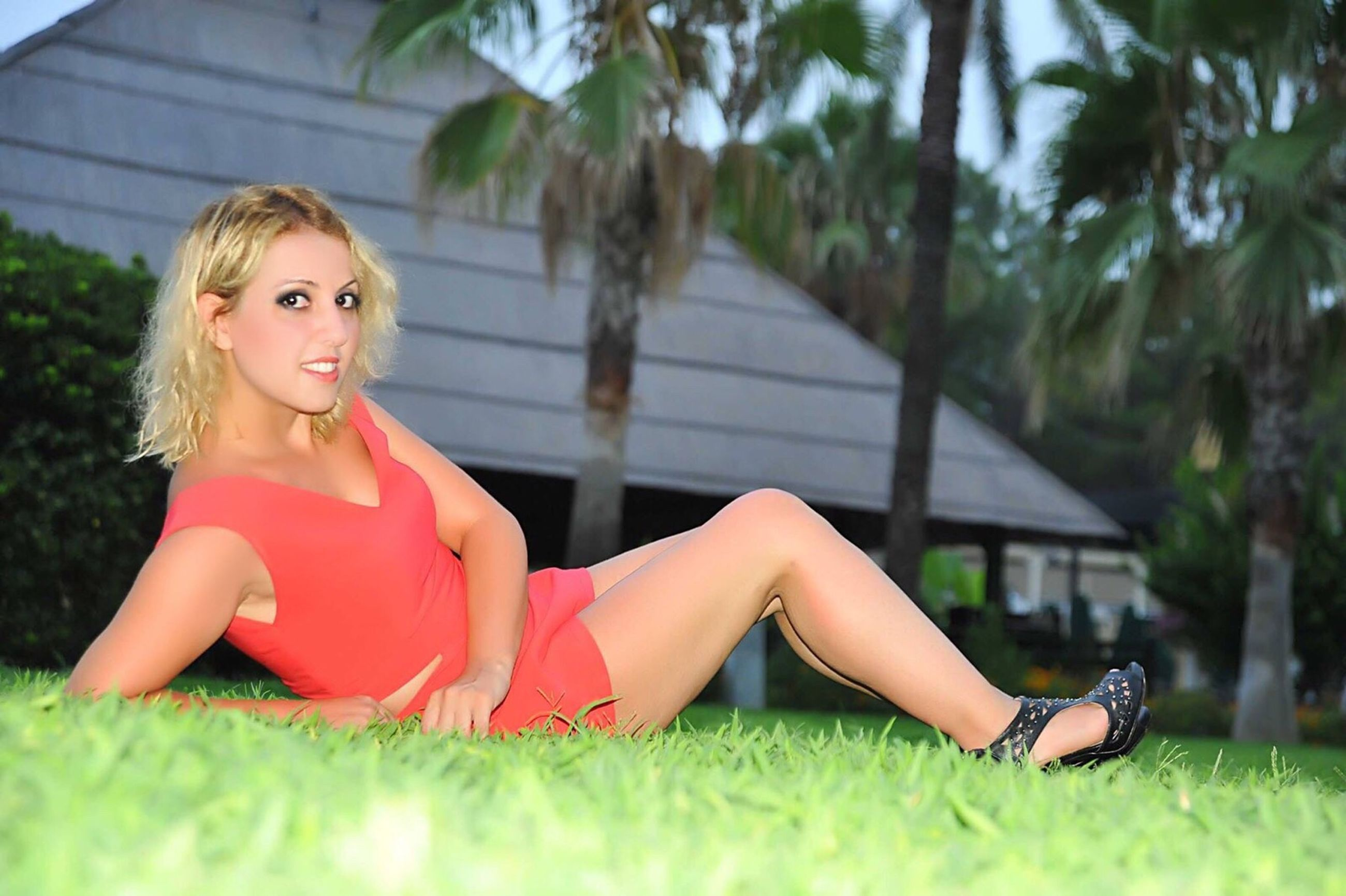 person, young women, grass, selective focus, young adult, long hair, leisure activity, sitting, casual clothing, lifestyles, full length, dress, beauty, lying down, summer, playing, red, day, relaxation, getting away from it all, cross-legged, outdoors, weekend activities, innocence, focus on foreground, nature