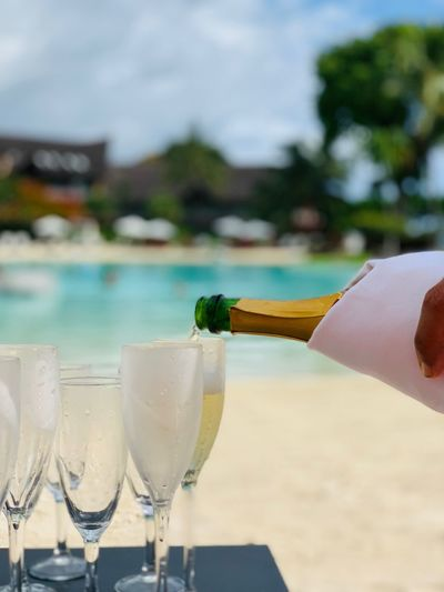 Island of freshness Hotel Beach Pool Champagne Glass Alcohol Refreshment Drink Food And Drink Human Body Part Human Hand Drinking Glass Freshness Champagne Close-up Champagne Flute Outdoors First Eyeem Photo