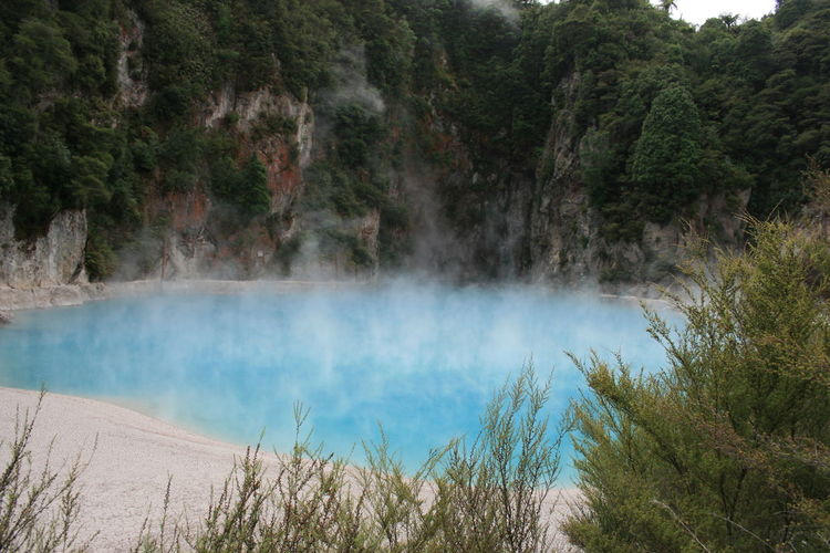 Scenic View Of Hot Spring Against Mountain