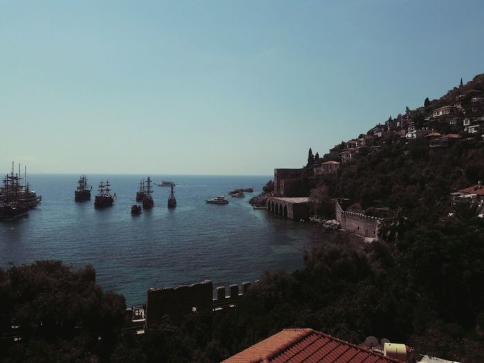 High angle view of tall ships in sea seen from mountain