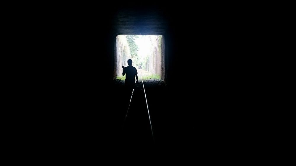 Silhouette Standing Solitude Light At The End Of Tunnel Exploration Journey Cairns, North Queensland, Australia Indoors  Silhouette Men Standing Darkroom Dark Solitude Light At The End Of Tunnel Exploration Light At The End Of The Tunnel Journey