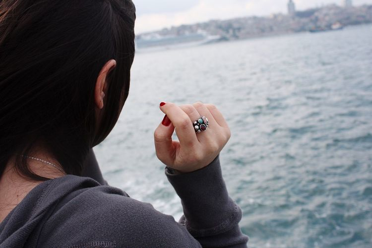 EyeEm Selects Water One Person Real People Rear View Women Sea Jewelry Ring Focus On Foreground Headshot Day Close-up Finger Ring Lifestyles Leisure Activity Outdoors Human Hand Nature Adult People Istanbul The Week Of Eyeem EyEmNewHere Let's Go. Together.