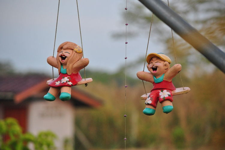 Close-up of toys hanging