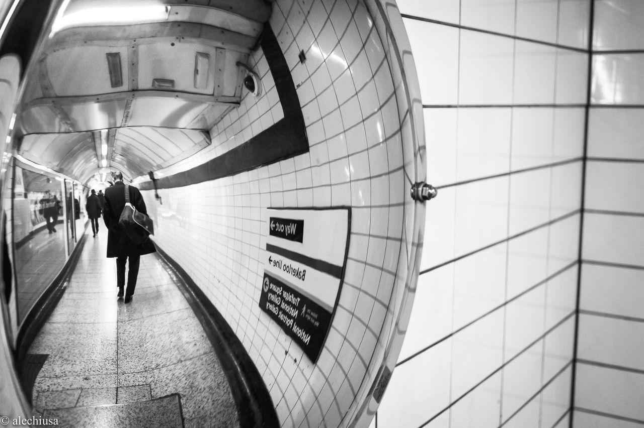 real people, walking, indoors, transportation, rear view, men, architecture, subway station, women, lifestyles, public transportation, leisure activity, full length, built structure, day, one person, people