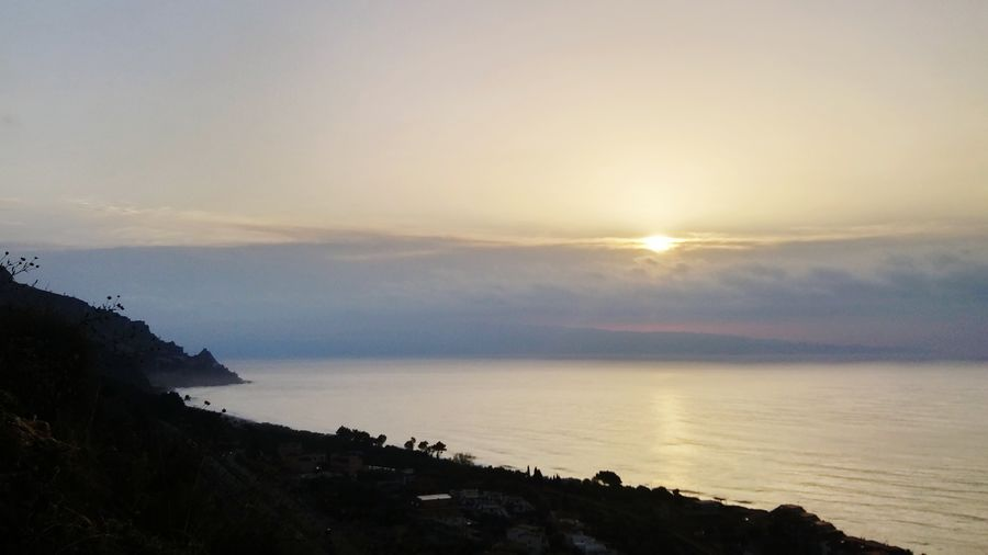 Sunrise over the Ionian sea Taking Photos Letojanni Sunrise Dawn Clouds And Sky Sea Shoreline Sicily Italy Reflection Backlight Sun Coast Coastline