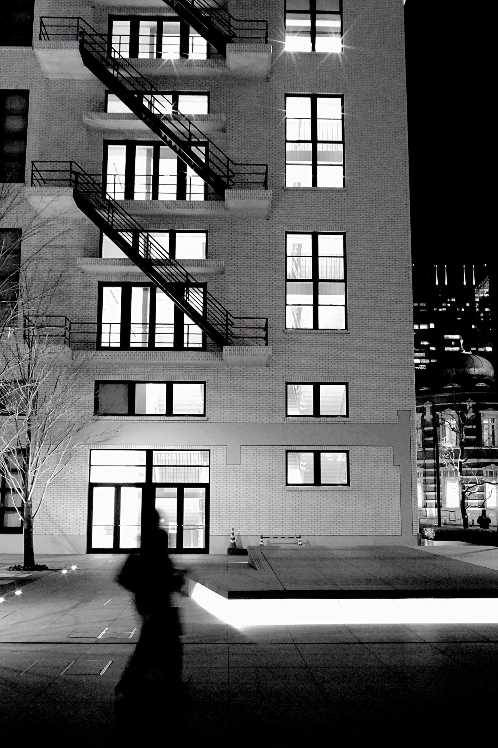 architecture, building exterior, built structure, city, street, building, window, city life, men, silhouette, shadow, lifestyles, unrecognizable person, walking, road, sunlight, transportation, residential building