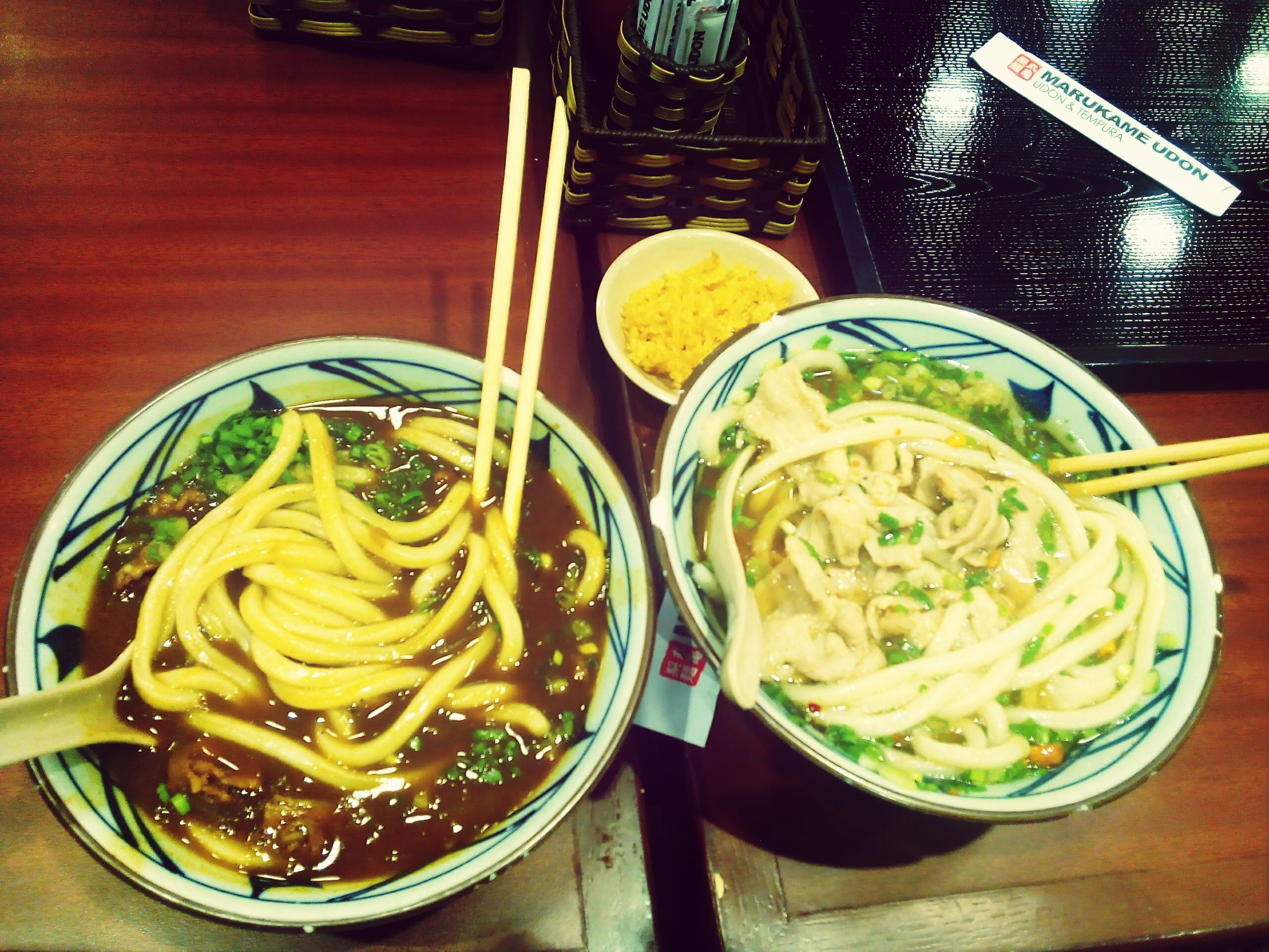 food and drink, indoors, freshness, food, table, healthy eating, bowl, still life, ready-to-eat, noodles, high angle view, plate, serving size, soup, drink, spoon, meal, chopsticks, close-up, drinking glass