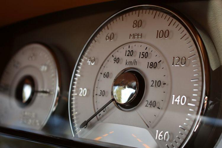 Close-up of speedometer in vintage car