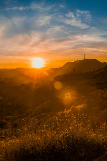 Hollywood Sunset 2 Sky Sunset Tranquility Beauty In Nature Tranquil Scene Sun Scenics - Nature Environment Sunlight Lens Flare Landscape Nature Orange Color Land Cloud - Sky Sunbeam No People Mountain Plant Non-urban Scene Outdoors Bright