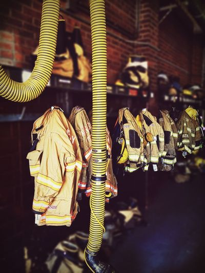 Tilt shift image of jackets at fire station