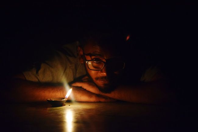 Eyeglasses  Only Men One Man Only Night Dark One Person Indoors  Close-up Human Hand Human Body Part Candle Flame