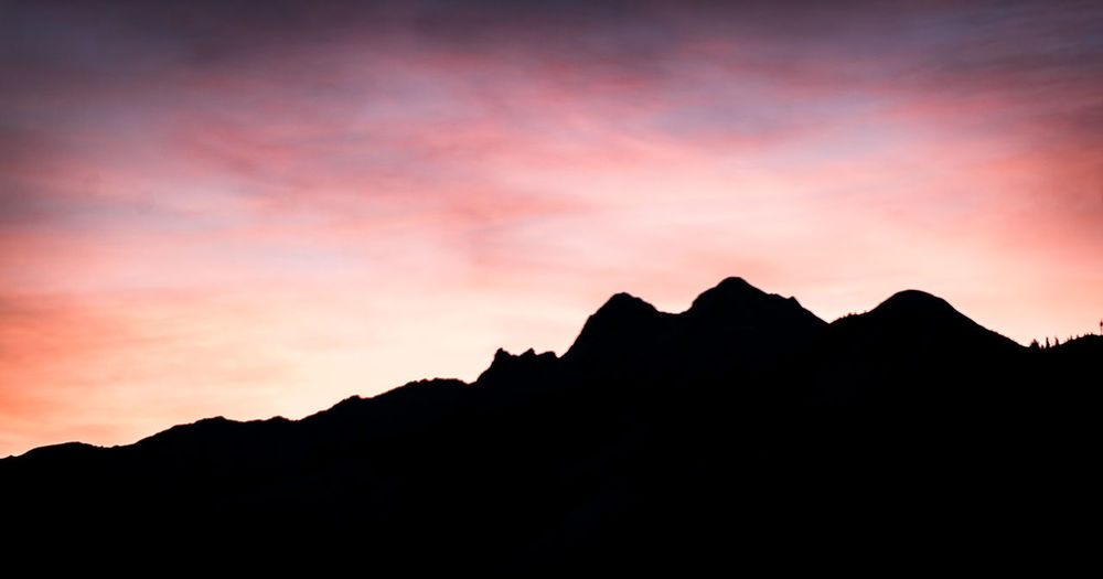 Sky Silhouette Mountain Sunset Tranquil Scene Beauty In Nature Tranquility Nature Scenics - Nature Mountain Range Cloud - Sky Dusk No People Orange Color Outdoors Idyllic Non-urban Scene Environment Copy Space Rock Mountain Peak