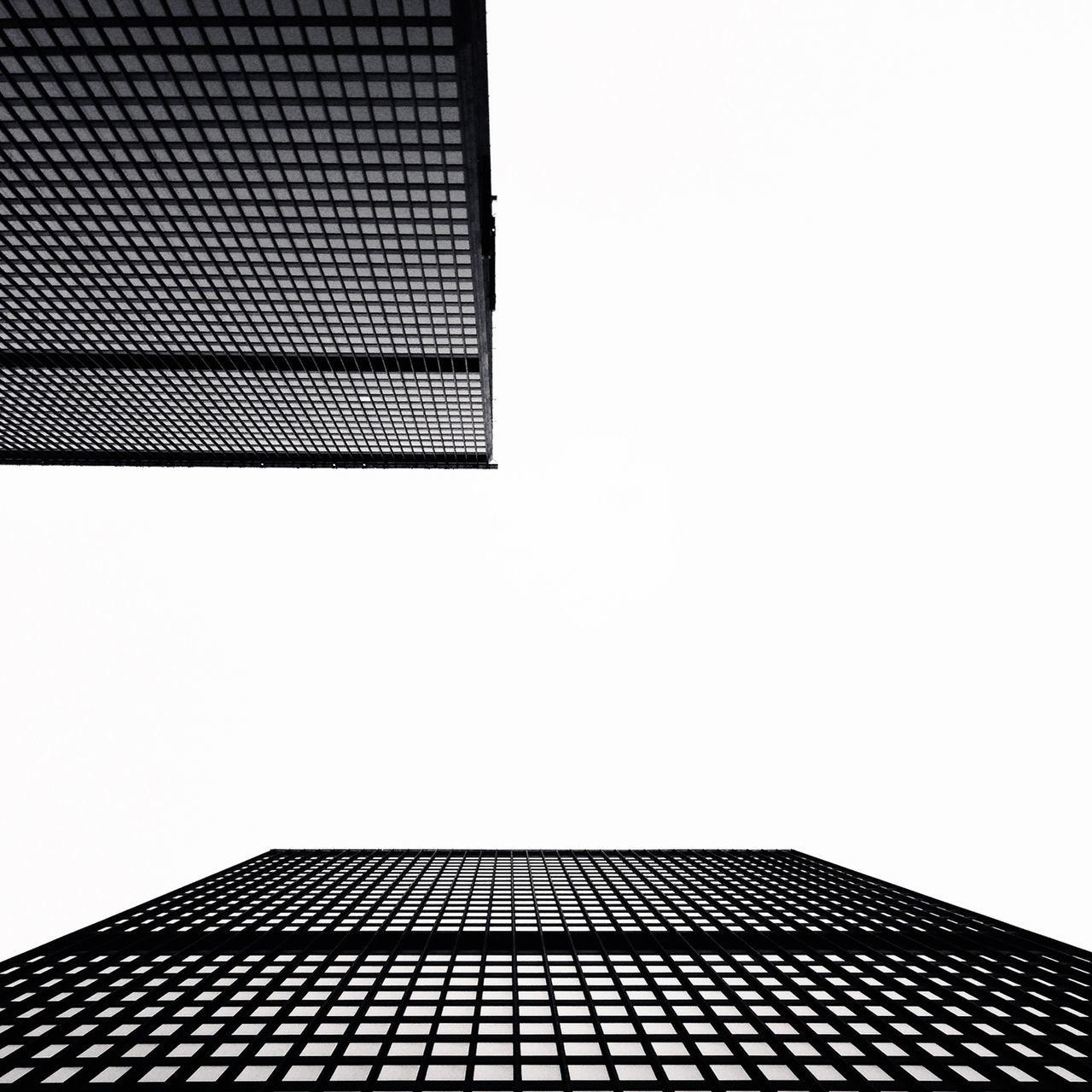 Directly Below View Of Modern Buildings Against Sky