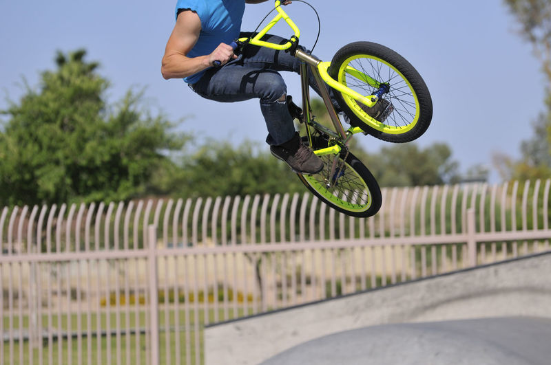 Man Performing Stunt With Bicycle