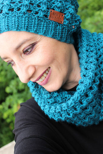 Close-up portrait of a smiling young woman in winter