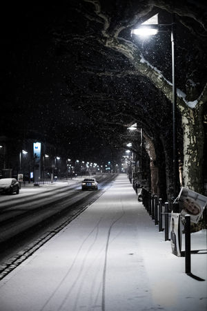 Architecture Building Exterior Built Structure City Cold Temperature Illuminated Night No People Outdoors Road Snow Street Light The Way Forward Transportation