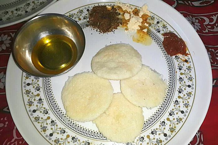 Time For Breakfast  South Indian Food Food Breakfast Idli This is a staple here; no matter where you go in South India you'll definitely come across a hotel or a stall that has idli on the menu. It's usually eaten with Ghee Chutney and something called 'podi' which is like a ground mixture of various spices and other dry stuff. @ Vijayawada Andhra Pradesh South India