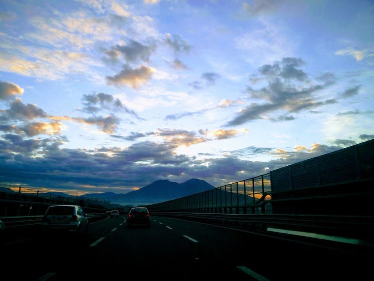 Travelling Vesuvio Tangenziale Di Napoli Sunrise Buona Serata  Happy Autoroute  Road Cloud - Sky Car Mountain Sky Outdoors Transportation City Day Nature Mobility In Mega Cities