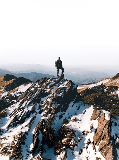 Full Length Snow Winter Cold Temperature One Person Nature Mountain Backpack Outdoors Rock - Object Hiking Day Adventure Scenics Tranquility Beauty In Nature One Man Only Real People Standing Landscape