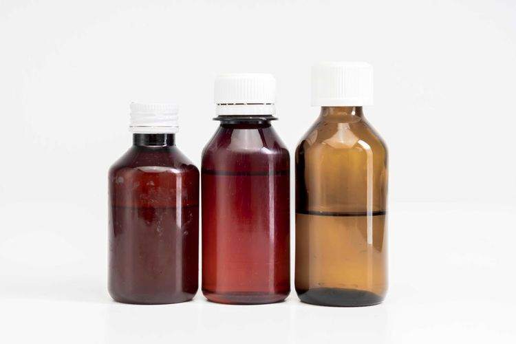 Bottle of medicine Bottle Studio Shot Container Indoors  White Background No People Healthcare And Medicine Glass - Material Still Life Copy Space In A Row Medicine Red Close-up Group Of Objects Cut Out Side By Side Reflection Science Clean