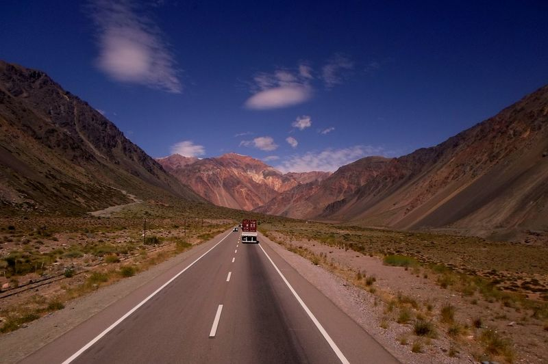 EyeEmNewHere Road Beauty In Nature Blue Blue Sky Clouds Day Dividing Line Highway Landscape Mountain Mountain Range Nature No People Outdoors Road Marking Scenics Sky The Way Forward Tranquil Scene Transportation Travel Vanishing Point