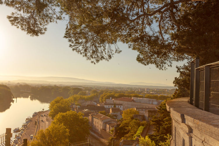 Wide view of Rona river and old city of Avignon, France Architecture Avignon Beauty In Nature Built Structure City Cityscape Day Hill Landscape Mountain Nature No People Outdoors Residential District Residential Structure Scenics Sky Tranquil Scene Tranquility Travel Destination Tree