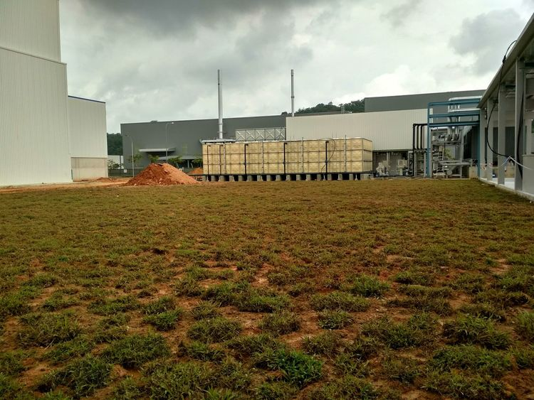 Turfing Area. Architecture Building Exterior Outdoors Day Sky Grass Contruction Contruction Zone Manufacturing Plant