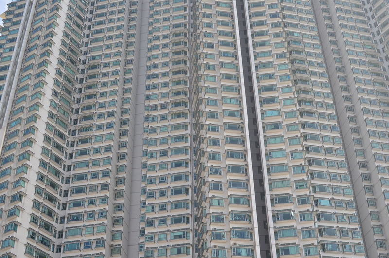 Patterns Apartment in Hong Kong Apartment Architecture Backgrounds Building Building Exterior Built Structure City Day Full Frame In A Row Low Angle View No People Office Office Building Exterior Outdoors Pattern Repetition Skyscraper Tall - High Window